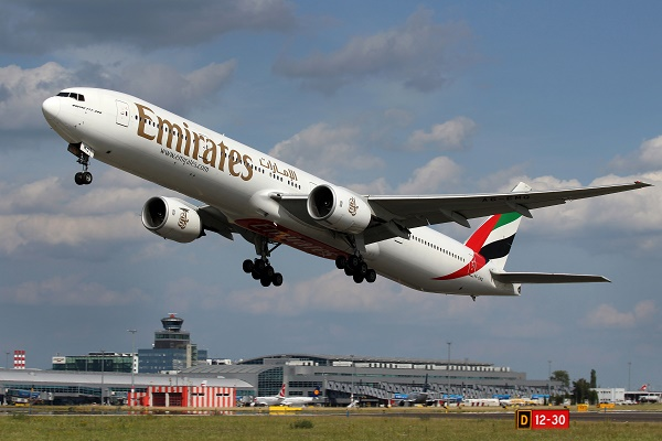 PRAGUE CZECH REPUBLIC - JUNE 28: Emirates Boeing 777-31H takes off from PRG Airport on June 28 2012. Emirates is rated as a top 10 best airlines in the world flying on youngest fleet.
