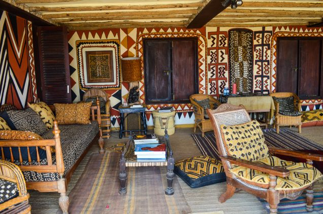 Fabrics with bold patterns from West Africa on the walls