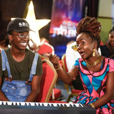 Celebrated African Comedian and host, Ann Kansiime engages one of the participants during the East Africa Got Talent pre-auditions powered by Safaricom at KICC, Nairobi.