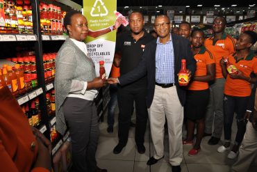 Kenya PET Recycling Company (PETCO) Chairman John Waithaka (right) and Naivas Supermarkets Capital Centre Branch Manager Maurice Mwangi (centre) launch drop-off points