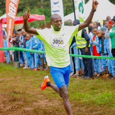 Michael Kunyuga crosses the finish line to win the men's senior race during The Henry Wanyoike Hope for the future run at Alliance High School grounds in Kikuyu.
