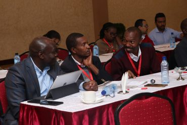DTB General Manager and Head of Business Kennedy Nyakomitta engages with traders Vincent Kabiru of Nanap Ventures and Insurance Agency and Peter Kimani of Homeland Insurance Brokers Ltd during the DTB MSME Financial Literacy Training Programme held in Nairobi.